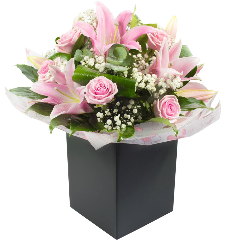 Sylvie a hand tied bouquet presented boxed and in water